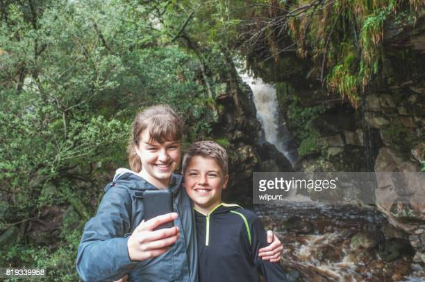 Two Teenagers Selfie at a waterfall