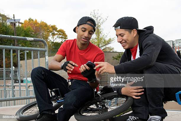 Two Teenagers using a Mobile