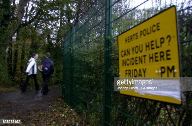 Two teenagers walk along a path towards Collenswood School in Stevenage Hertfordshire near where a 14yearold girl was attacked and raped last Friday...