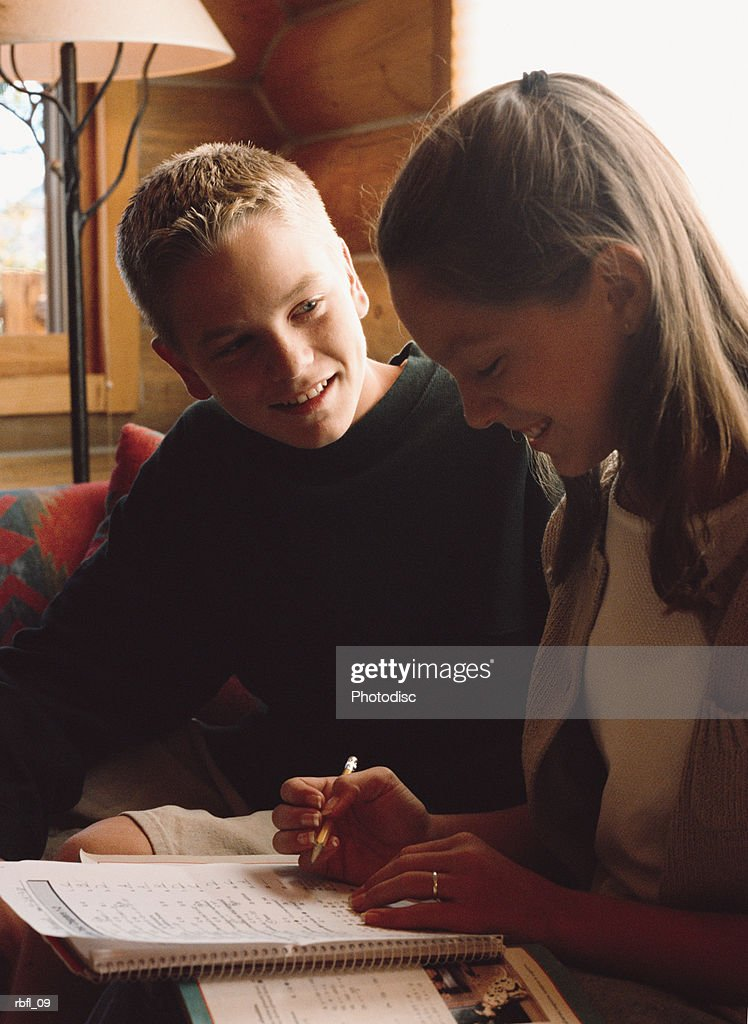 two teenagers working on a writing assignment together : Stockfoto