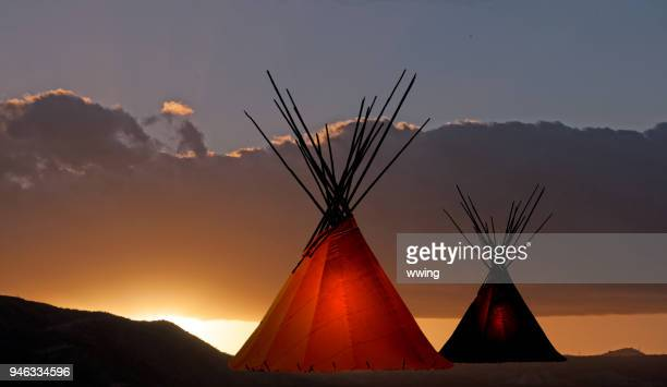 two teepees at sunset - first nations stock pictures, royalty-free photos & images