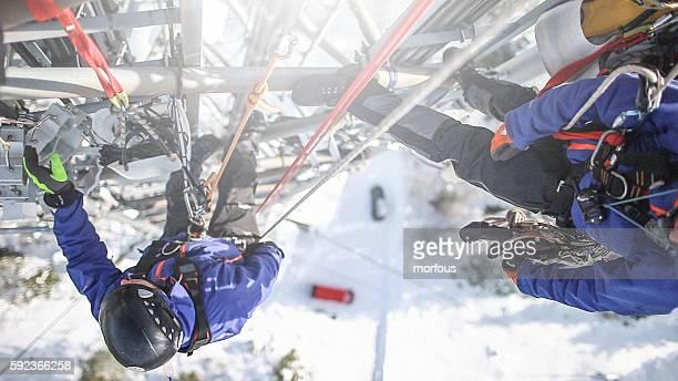 two telecommunication manual high worker engineers repairing antenna - tuig mast stockfoto's en -beelden
