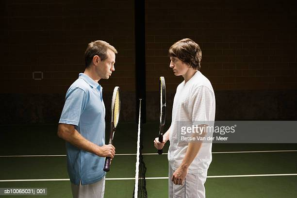 Two tennis players face to face, side view