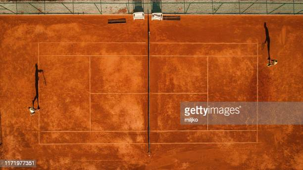 two tennis players on court - tennis player stock pictures, royalty-free photos & images