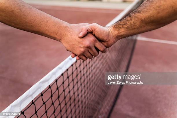 two tennis players shaking hands across the net - finale ストックフォトと画像