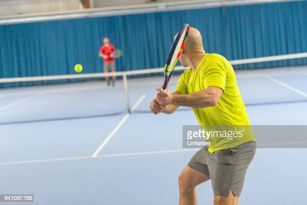 Twee Tennisplayer in een match