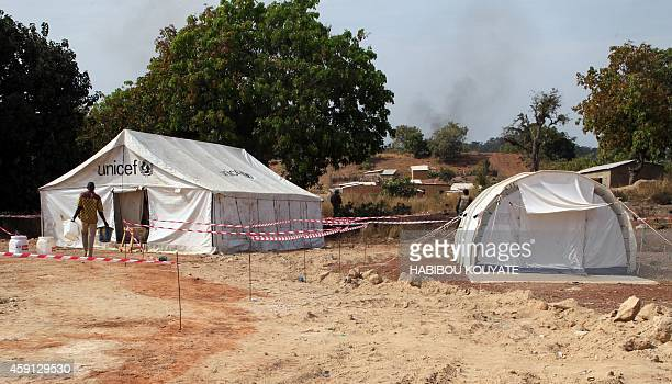 Two tents to treat potential Ebola virus patients are set up on November 17 2014 in the village of Kouremale near the border with Guinea Mali has...