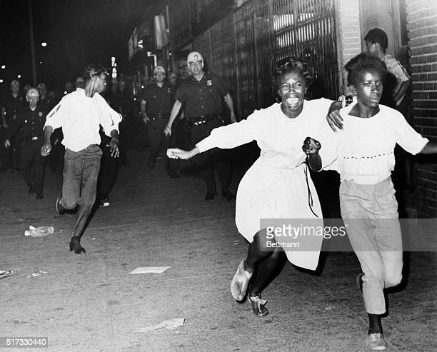 Two terrified African American girls flee police officers during a race riot in the BedfordStuyvesant neighborhood of Brooklyn This is the second...