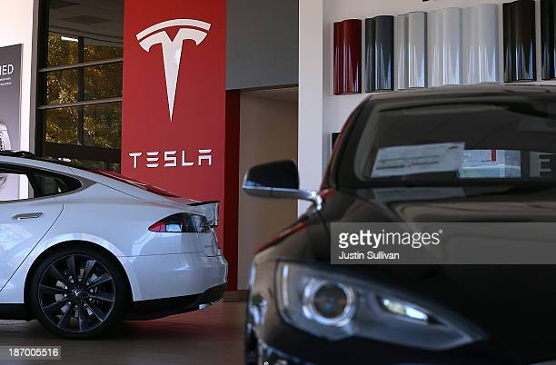 Two Tesla Model S cars are displayed at a Tesla showroom on November 5 2013 in Palo Alto California Tesla will report third quarter earnings today...