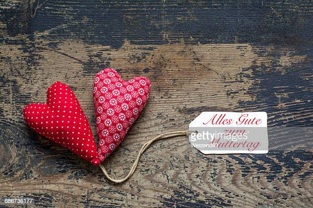 Two textile hearts with tag, saying All the best for Mothers Day