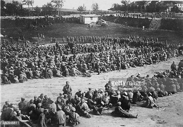 Two thousand Russian prisonersofwar captured by the Germans in East Prussia during World War I receiving their provisions in the camp circa 1914...