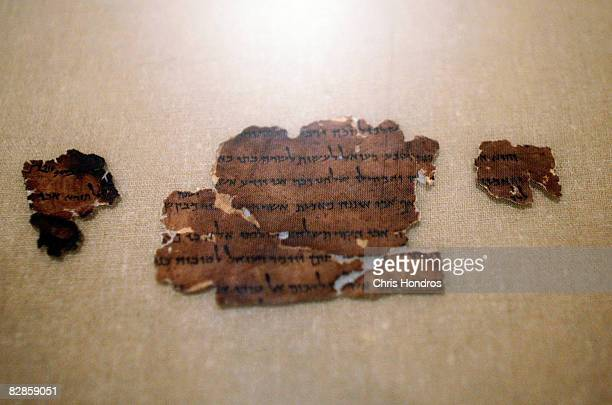 """Two thousand-year-old fragment from the Dead Sea Scrolls is seen on display at The Jewish Museum September 17, 2008 in New York City. """"The Dead Sea..."""