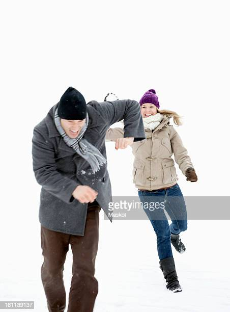 two throwing snowballs - ducking stock pictures, royalty-free photos & images