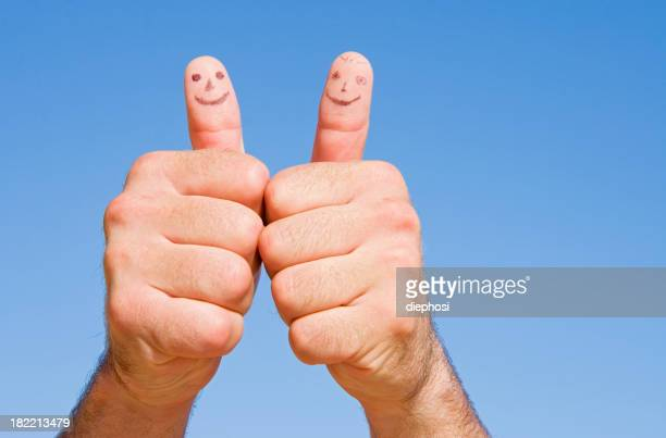 two thumbs faces