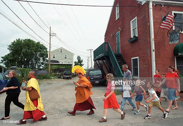 Two Tibetan Buddhist monks carry the sand from a healing mandala through the streets of Newburyport to the Merrimack River The monks offered the...