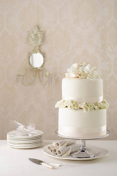 Two tier wedding cake with knife and plates photos two tier wedding cake with knife and plates wall art photo id 179706895 junglespirit Choice Image