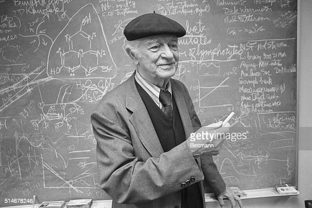 Two time Nobel Prize winner Linus Pauling stands at the blackboard in his chemistry laboratory.