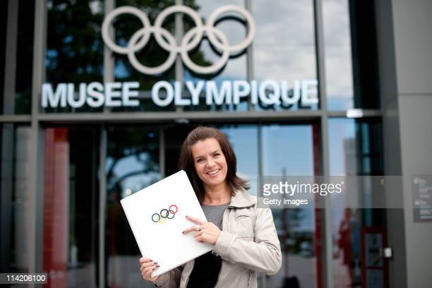 Two time Olympic Gold Medalist and Chair of Munich 2018 Katarina Witt signs the Golden Book of Lausanne ahead of the 2018 Briefing of IOC members at...