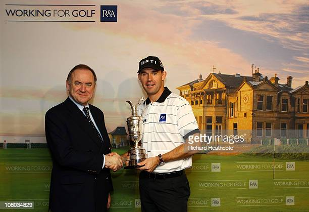 Two time Open Championship winner Padraig Harrington of Ireland and Peter Dawson, Chief Executive of The R&A pose for a picture after Harrington is...