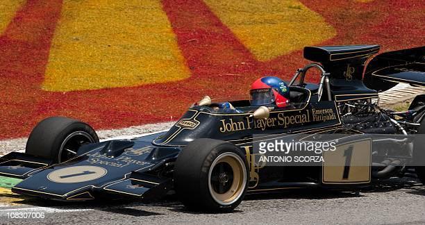 Two times F1 world champion , former Brazilian driver Emerson Fittipaldi, powers his Lotus 72 model before the Brazilian Grand Prix at Interlagos...