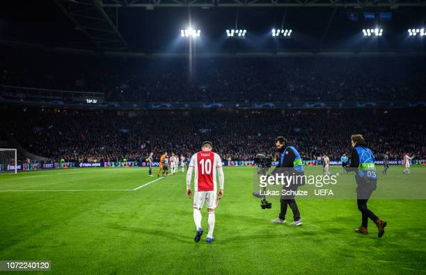Two times scorer Dusan Tadic of Amsterdam looks dejected after 3:3 result of the UEFA Champions League Group E match between Ajax Amsterdam and FC...
