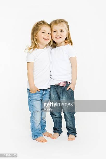 Two toddler girls hugging