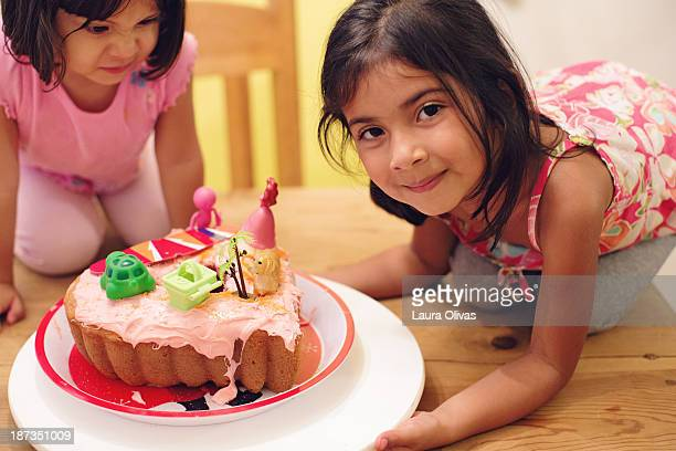 Two toddlers and an ugly cake