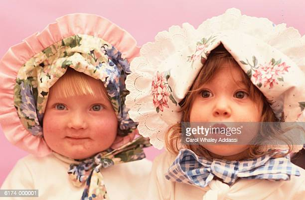Two Toddlers in Bonnets