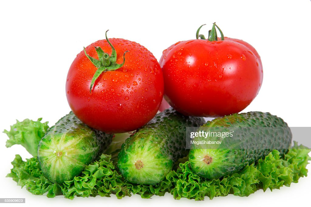 Two tomatoes and three cucumber : Stock Photo