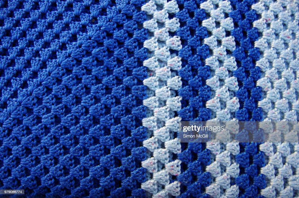 Two tone blue crotcheted blanket : Stock Photo
