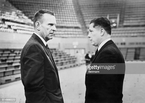Two top Teamster bosses look lonely as they chat surrounded by empty seats in the fieldhouse of the University of Detroit. Owen B. Brennen and James...