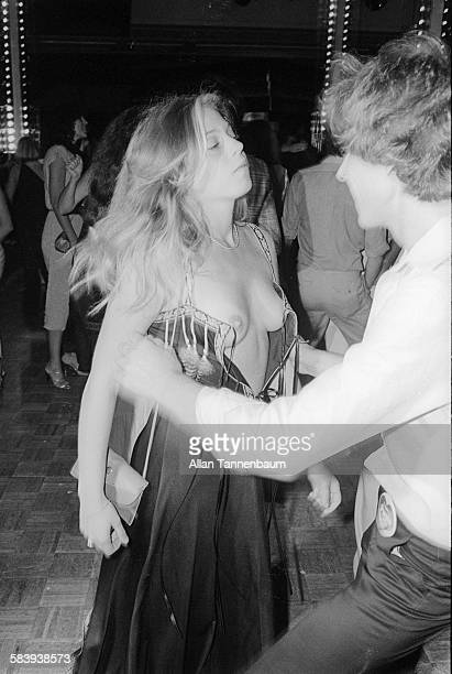 Two topless women dance at the Purple magazine party at Studio 54 New York New York September 15 1977