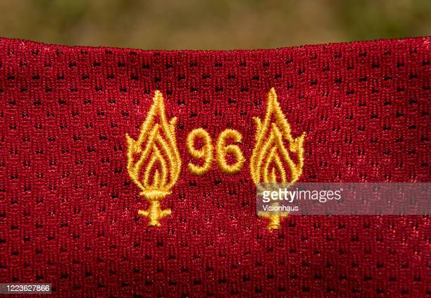 Two torches on the neck of the Liverpool first team home shirt to commemorate the 96 people who lost their lives at Hillsborough on May 4 2020 in...