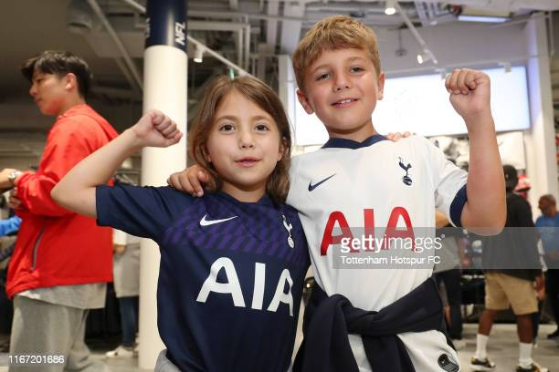 Two Tottenham Hotspur fans pose for a team photo prior to the Premier League match between Tottenham Hotspur and Aston Villa at Tottenham Hotspur...