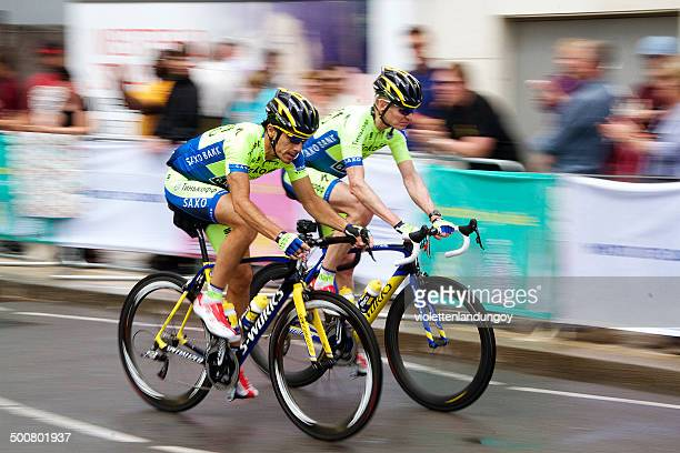 two tour de france cyclists in london - cycling event stock pictures, royalty-free photos & images