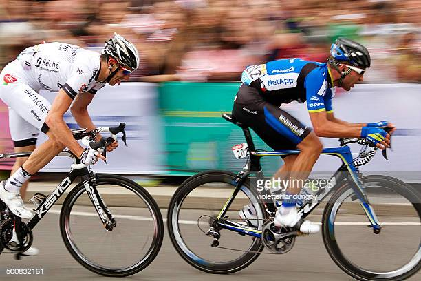 two tour de france cyclists in london (2014) - cycling event stock pictures, royalty-free photos & images