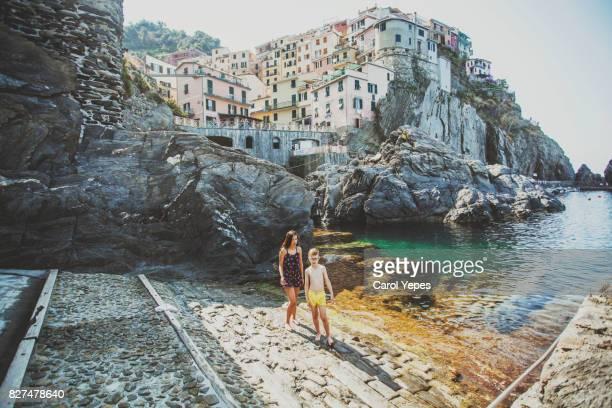 two tourist enjoying day in Riomaggiore.Cinque Terre,Italy