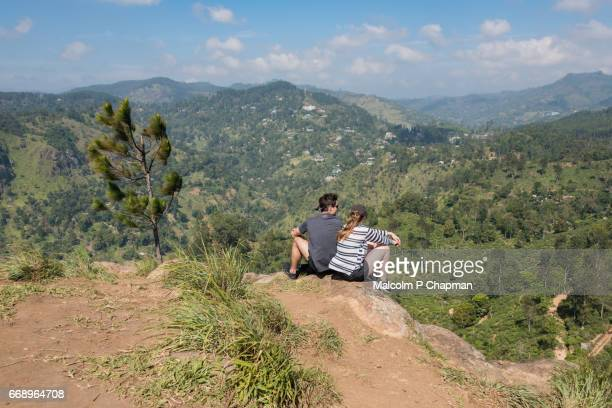 Two tourists enjoy the view from Little Adam's Peak, Ella, Sri Lanka