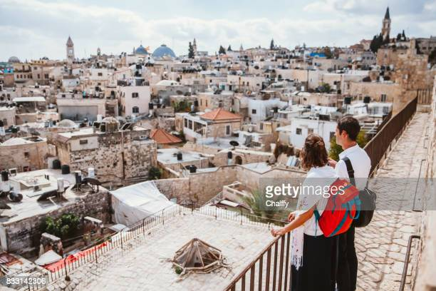two tourists looking at the jerusalem old city - jewish people stock pictures, royalty-free photos & images