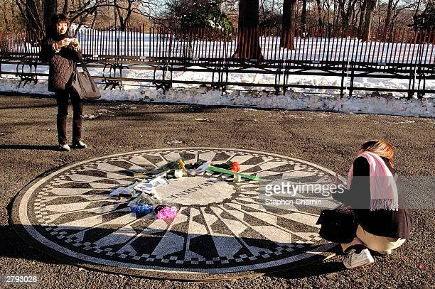 Two tourists make photographs of their visit to the Imagine tribute to former Beatle John Lennon December 8 2003 at Central Park's Strawberry Fields...