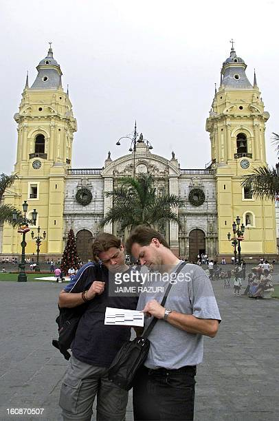 Two tourists read a guide book in the Plaza Mayor in Lima Peru 03 January 2001 The president of the National Commission of Tourism indicated 02...