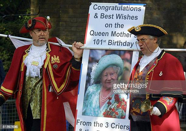 Two towncriers shout praise waiting to greet the Queen mum on her 101st birthday at Clarence house in London 04 August 2001 Hundreds of people have...