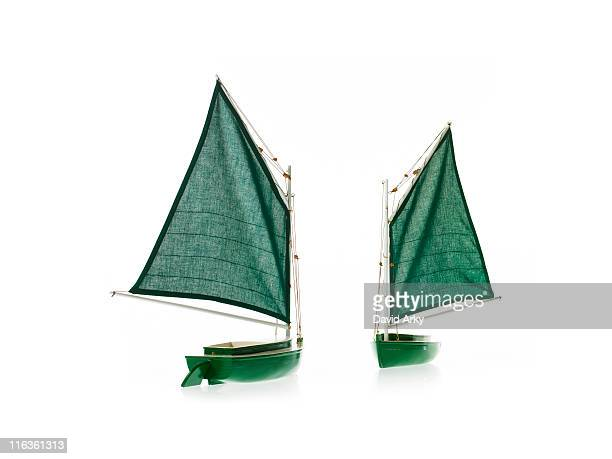 Two toy boats on white background