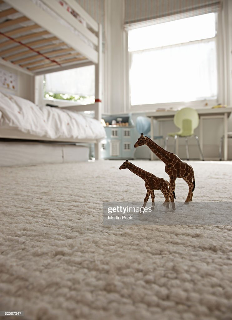 two toy giraffes on childrens bedroom floor : Stock Photo