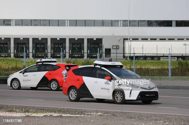 Two Toyota Motor Corp Prius hybrid cars operated by YandexTaxi part of YandexNV take part in selfdriving taxi trial on a test track in Mikhnevo...