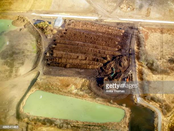 CONTENT] Two tractors work next to an evaporation pond at a work site in Southern Ontario Canada