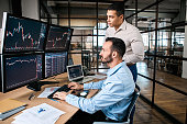 Two trader checking global currency index on fund exchange