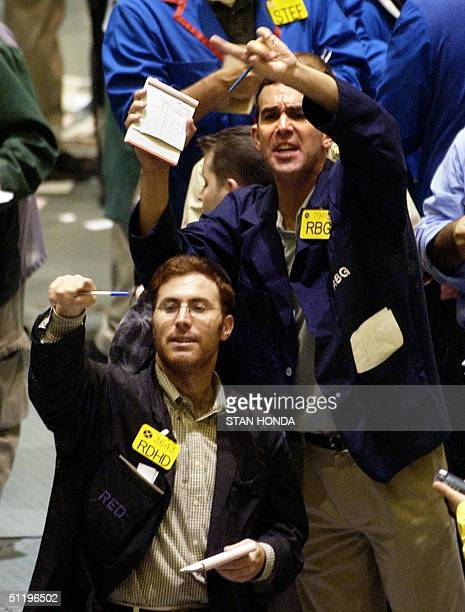Two traders gesture and shout for attention in the crude oil futures pit 20 August on the floor of the New York Mercantile Exchange World oil prices...