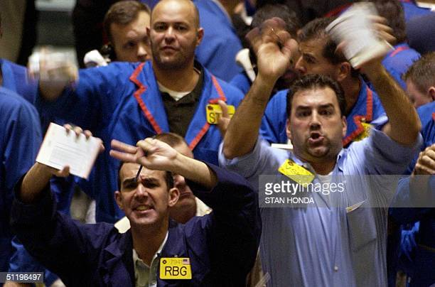 Two traders shout for attention in the crude oil futures pit 20 August on the floor of the New York Mercantile Exchange World oil prices hit new...