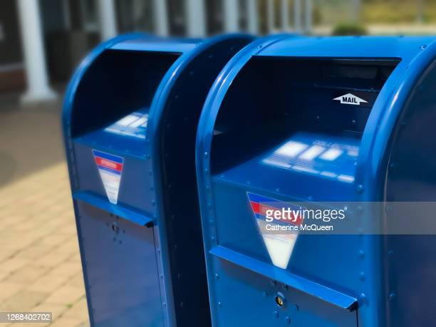 two traditional blue postal mailboxes side by side - post office stock pictures, royalty-free photos & images